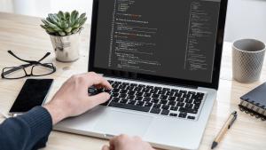 man programming on a computer office background TU3LPFY