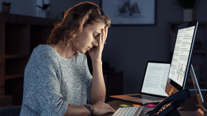 stressed woman working over time at night 6CTDVYS